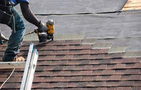 roofing contractor on home